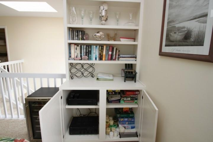Wine cooler, sound system, games and books