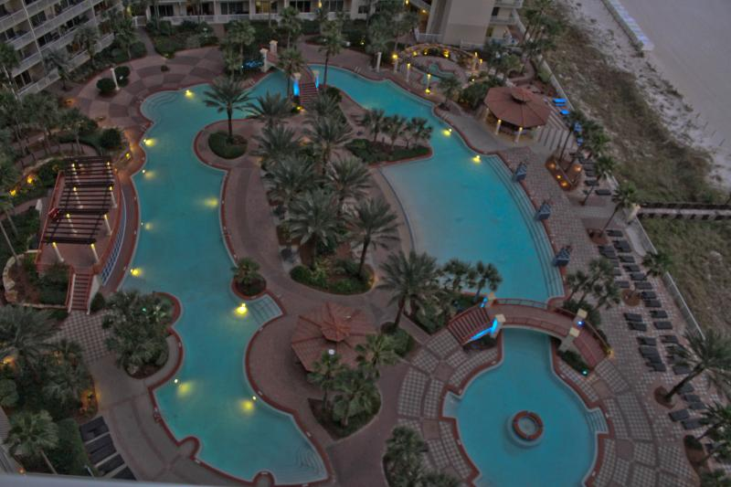 Dusk view from our balcony of the Shores of Panama pool deck.  Best pool deck in Panama City Beach