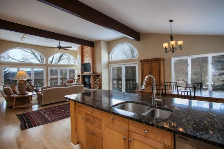 Open floor plan with upgraded kitchen, bright living room and large dining table for 6.