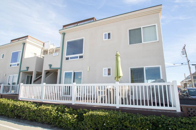 Private, elevated, & fenced patio keeps children from running off and provides additional security.