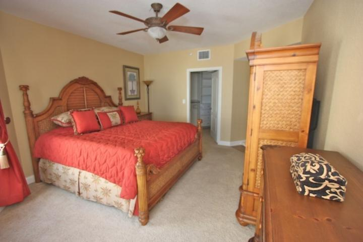 Master Bedroom with King Bed/Flat Screen Cable TV/Walk-In Closet/Access to Private Patio overlooking The Amazing Gulf of Mexico