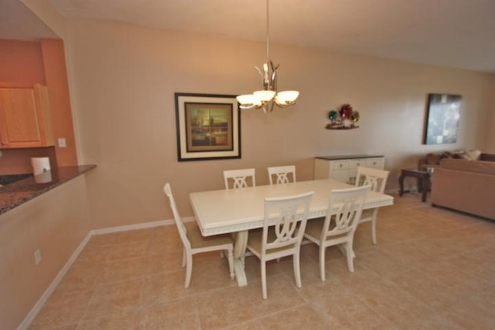 Open Dining Area with Seating for 5. Enjoy a Savory Meal while Gazing out into the Beautiful Clearwater Intercoastal