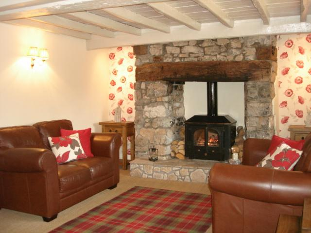 Lounge Area with inglenook fireplace, log burner, beamed ceilings and original ledge & brace doors