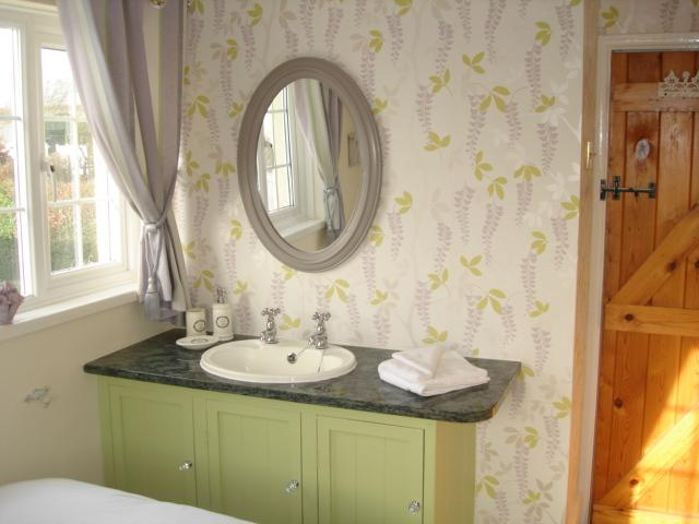 Bedroom 4 has a small double, vanity unit and superb sea views