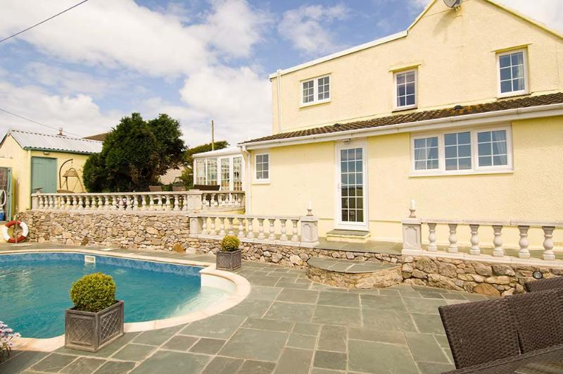 Outdoor breakfast terrace and lower patio area with Roman End Heated pool, Gas BBQ and sea views