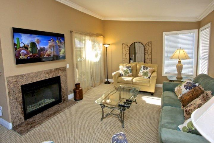 Watch your favorite shows on this adjustable flat screen TV over the gas burning fireplace