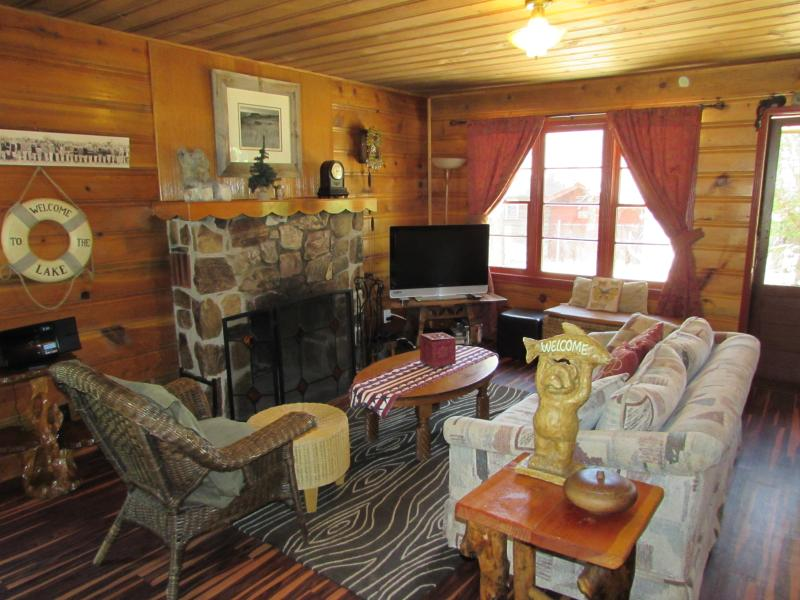 Relax and enjoy the Native rock fireplace or flat screen TV, your choice.