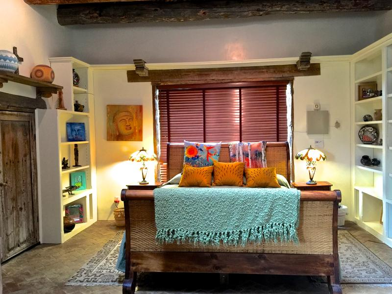 Nice size CA King Sleigh bed, with a large picture window and secret door in the main bedroom.