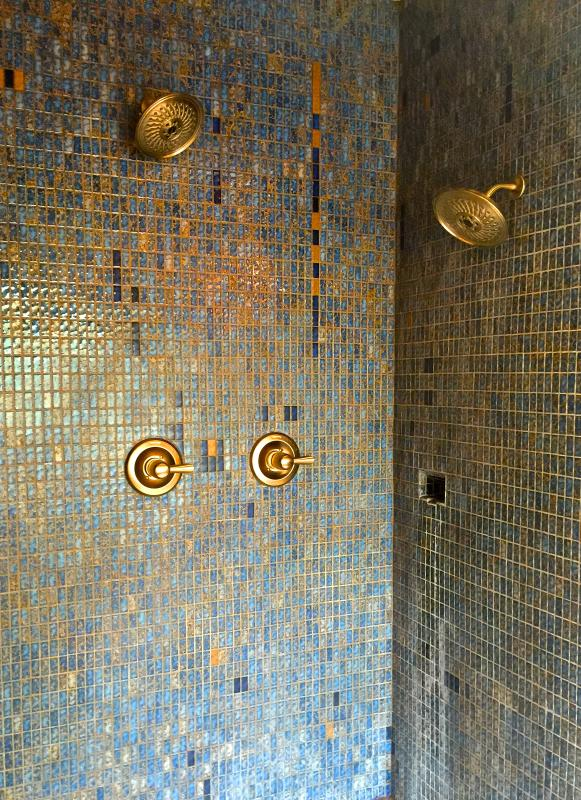 Double rain shower heads for a luxurious shower or use the adjacent soaker tub to relax your muscles