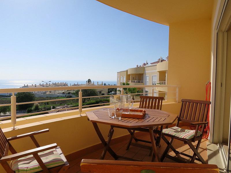 The living room veranda overlooks the pool area and has fabulous sea views