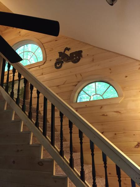beautiful pine wood walls and stair case. New carpet on floors upstairs.