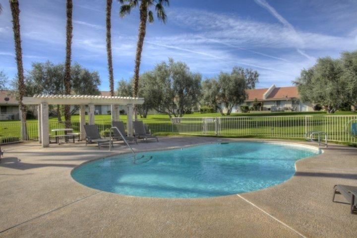 Relax poolside or dive in at the gated community pool