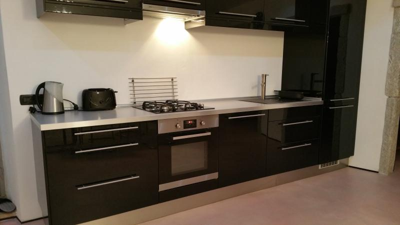 Excellent equipped contemporary kitchen.