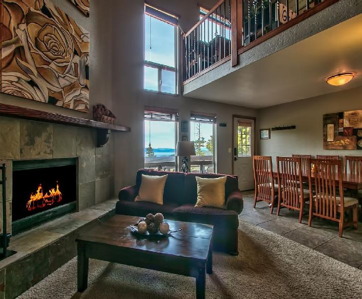 Livingroom with spectacular views through these windows of beautiful Lake Tahoe