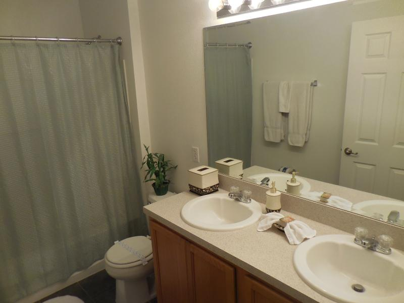 Upstairs Queen en suite bathroom with full bath / shower and twin hand basins