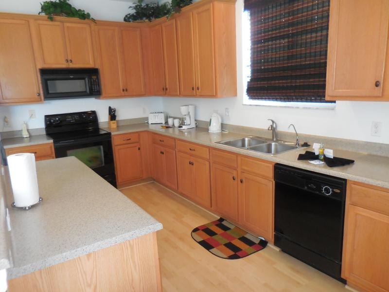Full kitchen with dishwasher, fridge, oven, kitchen island w seating for 3