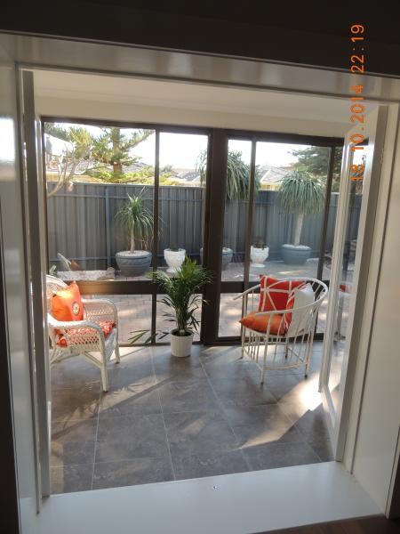 One of the sunrooms that over looks the private front courtyard garden.