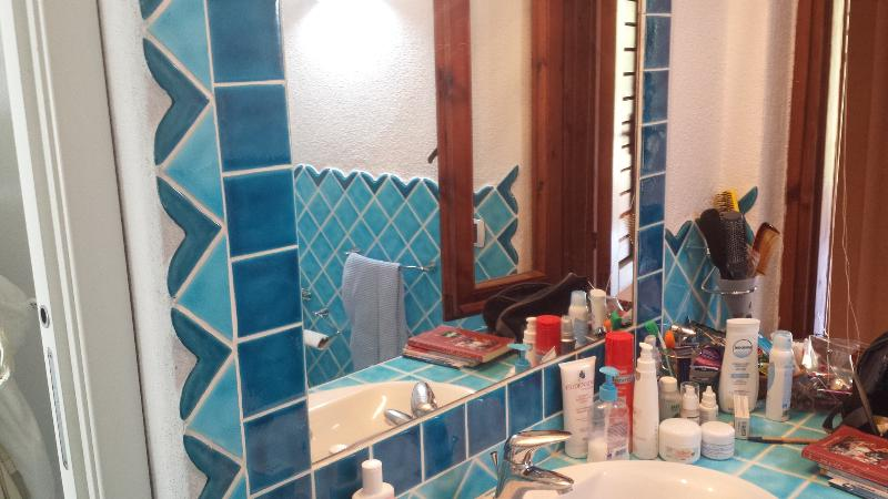 Wall mirror in the bathroom with window and shower