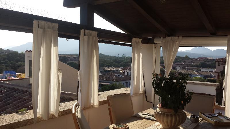 Ptivate Veranda with table and chairs, curtains for privacy and sun