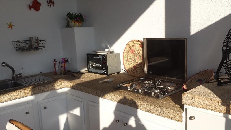 Open kitchen in the private veranda