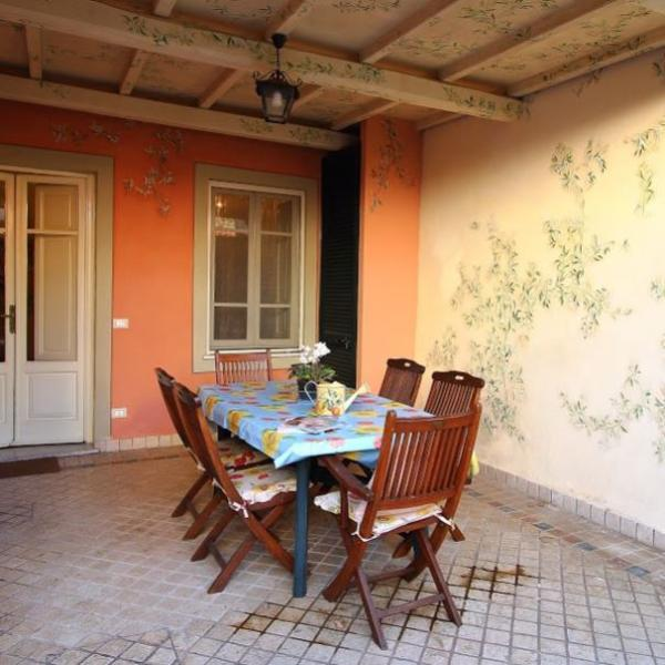 Dining on the patio with olive frescoed walls