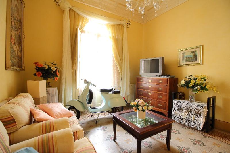 Sitting room with vintage Vespa