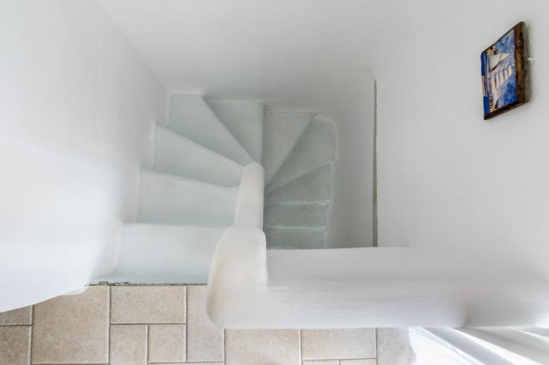 Tradition built stairs to down floor.