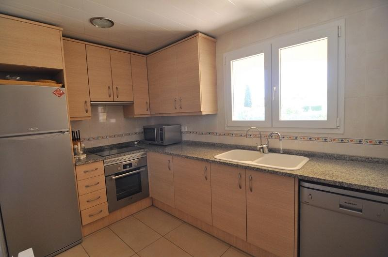 Kitchen with fridge, oven, hob, microwave, dishwasher, toaster and coffee maker