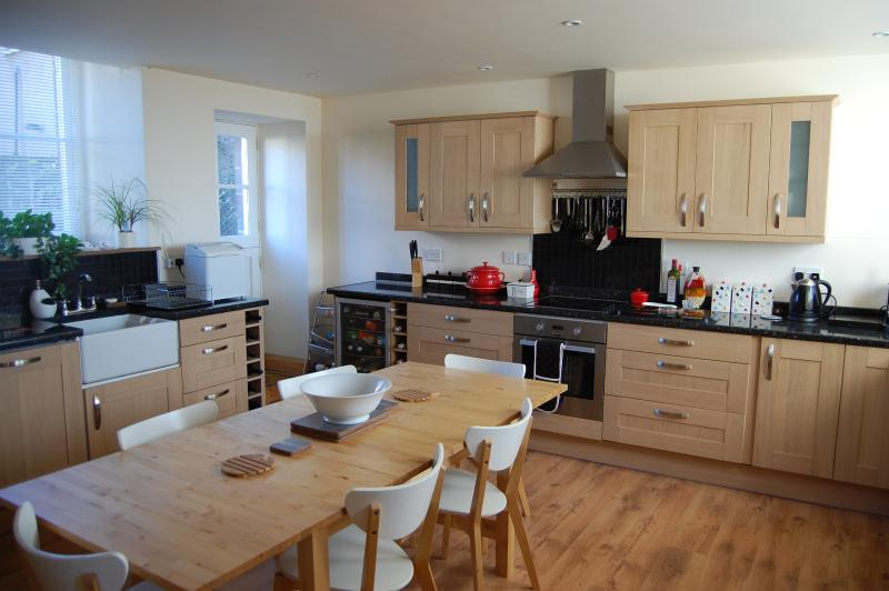 Spacious and well equipped oak kitchen.