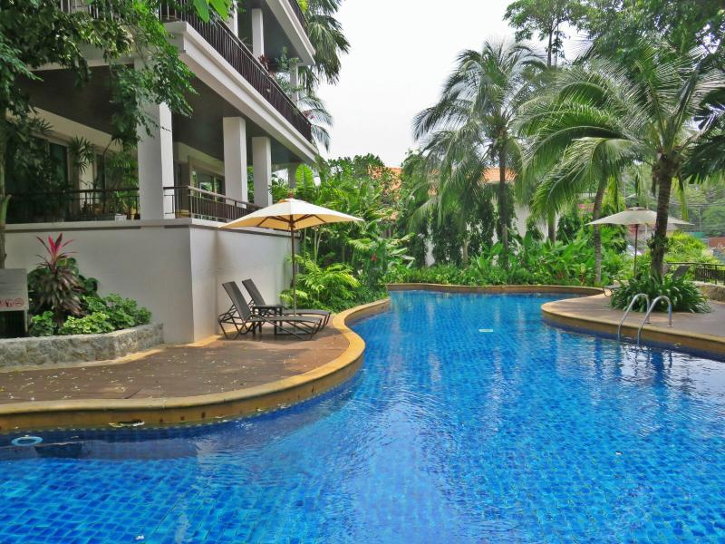 View of terrace overlooking one of two beautiful Commin area swimming pools