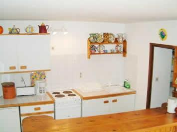 The very 'workable' kitchen.  The pantry is to your right. The bar is good for serving and storage.