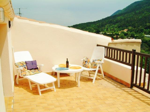 The roof terrace (off the living-room). Panoramic views to the village, castle and mountains.