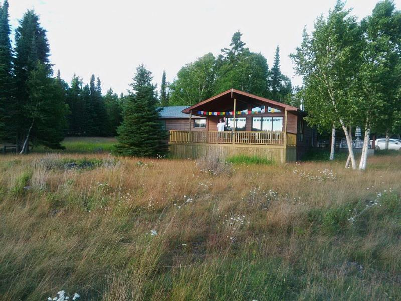 The house nestled among the trees on the 2 acre property, surrounded by  constantly changing views.