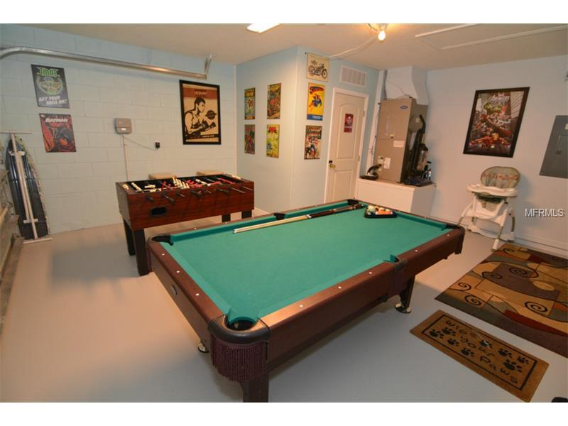 Games Room With Pool Table / Foosball.