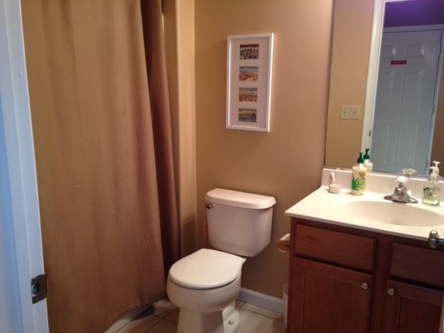 This is the bathroom in the hall. It has a full tub and shower.