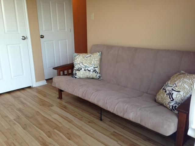 The futon in the third bedroom. This photo shows the bamboo floors' true color throughout the condo.