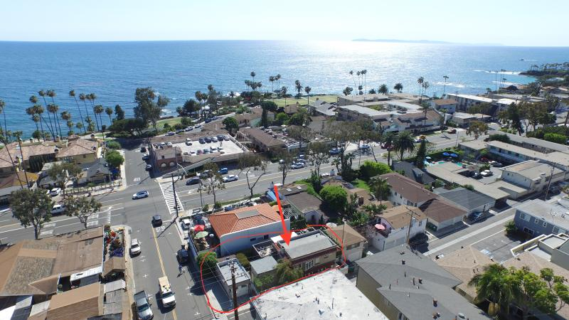 Aerial view of the house, the street and the beach