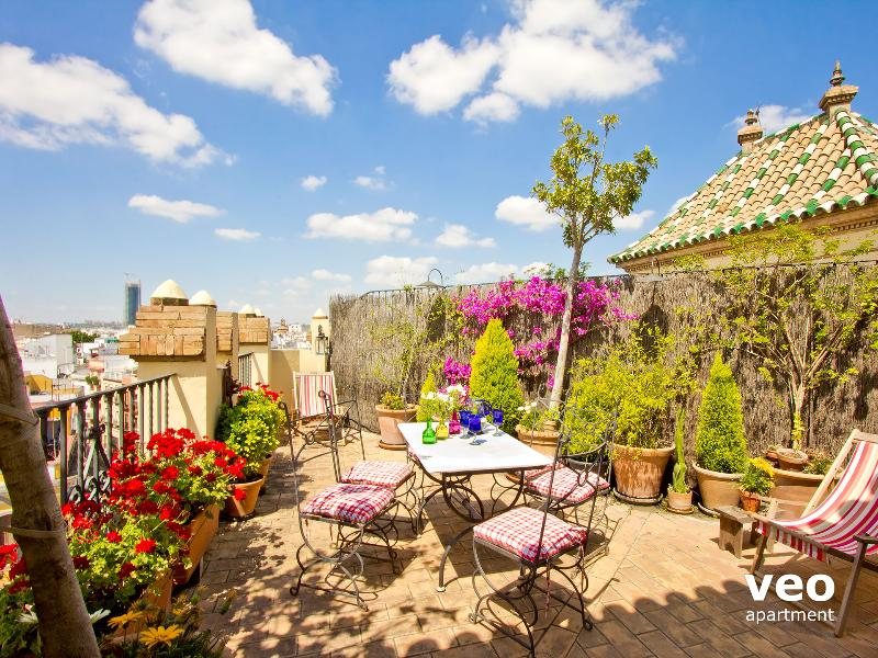 Private terrace with outdoor furniture: 2 deck-chairs, dining table, chairs and parasol.