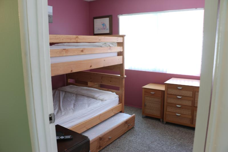 Bedroom 2 - full over full with twin trundle.  Mounted TV, ceiling fan, portable fan