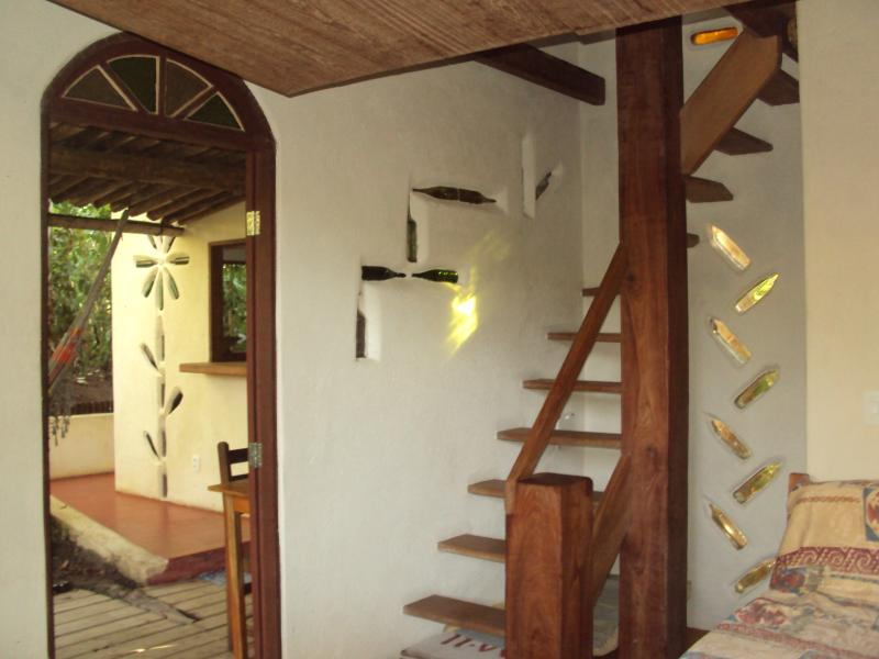 Stairs to the bedroom  and entrance to the bathroom on the right of the stairs