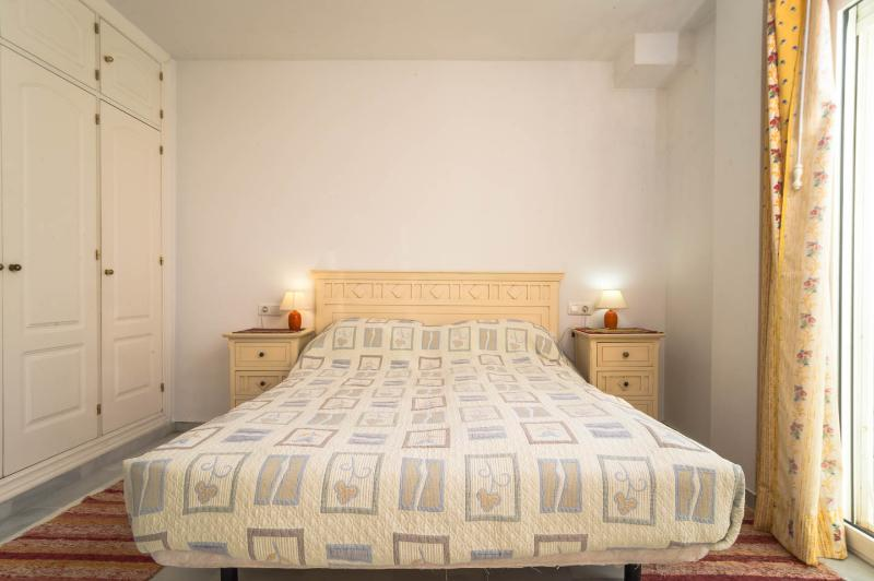 Large bedroom houses large size bed, en-suite bathroom and space for further bed or sofa and chairs
