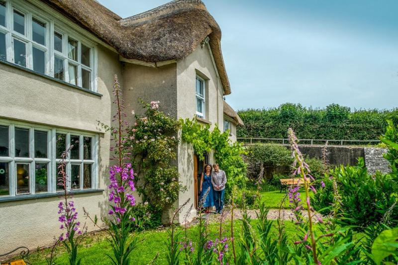 Middle Coombe Farm's Grade II* listed thatched farmhouse accommodation