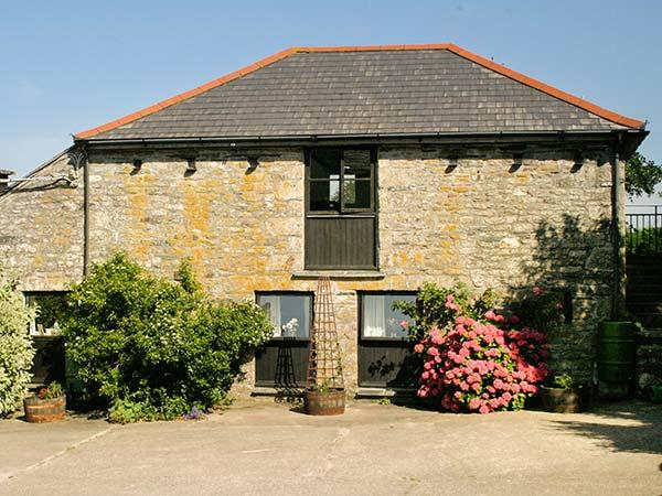 DOVE COTTAGE solid fuel stove, shared use of hot tub and sauna, romantic, vacation rental in Helstone