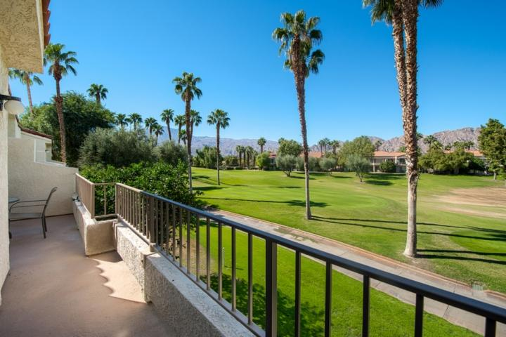 Patio with view of PGA West TPC Nick Tournament Golf course and mountains in background facing southwest