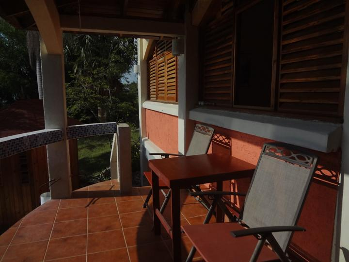 Guest suite private veranda with steps down to the pool deck, 2nd kitchen and cabana.