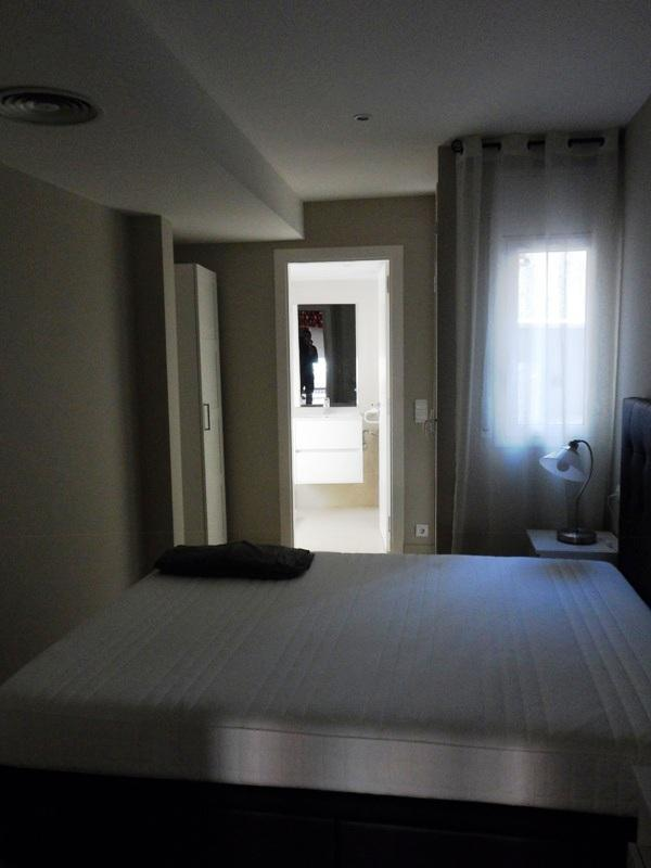 a view through the bedroom to the bathroom
