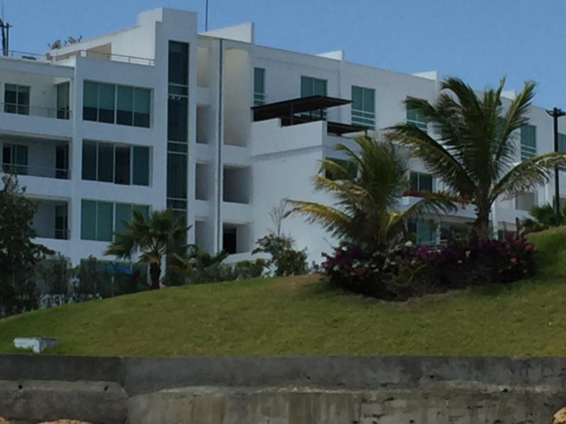 Standing on the beach with view of condo