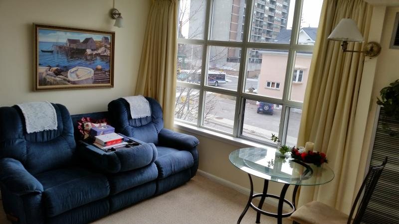 Open concept unit includes very comfortable living room.