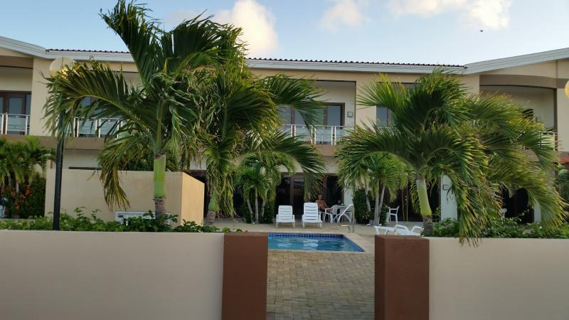 A photo from the parking lot of Aruba Breeze - Our Unit C-5.  Right in front of smaller pool.