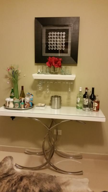 Small bar in kitchen.  We provide barware and the wine.